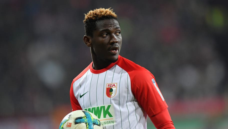 AUGSBURG, GERMANY - JANUARY 13: Daniel Opare of Augsburg holds the ball in his hand during the Bundesliga match between FC Augsburg and Hamburger SV at WWK-Arena on January 13, 2018 in Augsburg, Germany. (Photo by Sebastian Widmann/Bongarts/Getty Images)