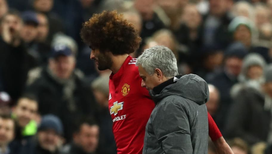 LONDON, ENGLAND - JANUARY 31:  Marouane Fellaini of Manchester United is embraced by Jose Mourinho, Manager of Manchester United during the Premier League match between Tottenham Hotspur and Manchester United at Wembley Stadium on January 31, 2018 in London, England.  (Photo by Catherine Ivill/Getty Images)
