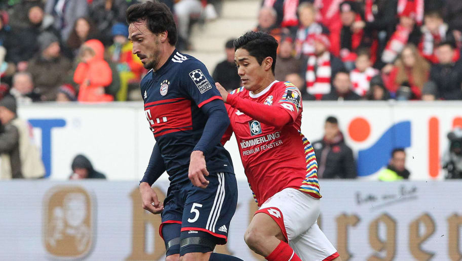 Mainz' Mainz' Japanese forward Yoshinori Muto and Bayern Munich's German defender Mats Hummels (L)vie for the ball during the German first division Bundesliga football match Mainz 05 versus Bayern Munich on February 3, 2018 in Mainz. / AFP PHOTO / Daniel ROLAND / RESTRICTIONS: DURING MATCH TIME: DFL RULES TO LIMIT THE ONLINE USAGE TO 15 PICTURES PER MATCH AND FORBID IMAGE SEQUENCES TO SIMULATE VIDEO. == RESTRICTED TO EDITORIAL USE == FOR FURTHER QUERIES PLEASE CONTACT DFL DIRECTLY AT + 49 69 650050         (Photo credit should read DANIEL ROLAND/AFP/Getty Images)