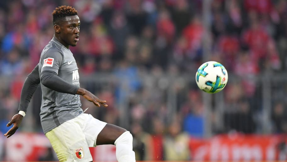 MUNICH, GERMANY - NOVEMBER 18: Daniel Opare of Augsburg plays the ball during the Bundesliga match between FC Bayern Muenchen and FC Augsburg at Allianz Arena on November 18, 2017 in Munich, Germany. (Photo by Sebastian Widmann/Bongarts/Getty Images)