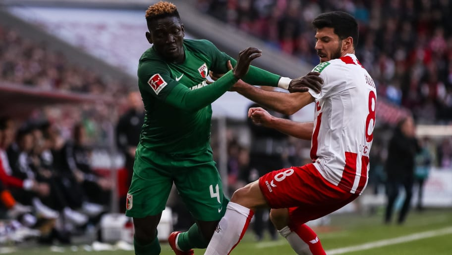 COLOGNE, GERMANY - JANUARY 27: Daniel Opare #4 of Augsburg and Milos Jojic #8 of 1.FC Koeln battle for the ball during the Bundesliga match between 1. FC Koeln and FC Augsburg at RheinEnergieStadion on January 27, 2018 in Cologne, Germany. (Photo by Maja Hitij/Bongarts/Getty Images)