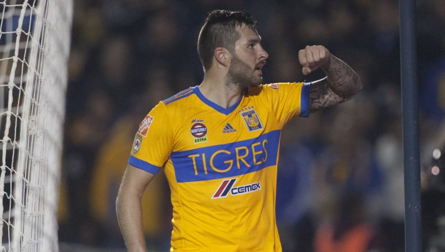 Tigres' Andre Pierre Gignac celebrates after scoring against Pachuca during their Mexican Clausura 2018 tournament football match at the Universitario stadium in Monterrey, Mexico on January 27, 2018.  / AFP PHOTO / Julio Cesar AGUILAR        (Photo credit should read JULIO CESAR AGUILAR/AFP/Getty Images)