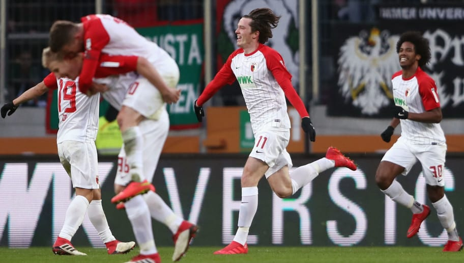 AUGSBURG, GERMANY - FEBRUARY 04:  Michael Gregoritsch of Augsburg celebrates his team's second goal during the Bundesliga match between FC Augsburg and Eintracht Frankfurt at WWK-Arena on February 4, 2018 in Augsburg, Germany.  (Photo by Alex Grimm/Bongarts/Getty Images)
