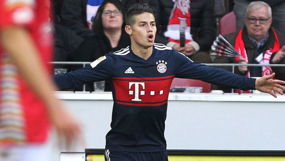 Munich's Colombian midfielder James Rodriguez celebrates after scoring during the German first division Bundesliga football match Mainz 05 versus Bayern Munich on February 3, 2018 in Mainz. / AFP PHOTO / Daniel ROLAND / RESTRICTIONS: DURING MATCH TIME: DFL RULES TO LIMIT THE ONLINE USAGE TO 15 PICTURES PER MATCH AND FORBID IMAGE SEQUENCES TO SIMULATE VIDEO. == RESTRICTED TO EDITORIAL USE == FOR FURTHER QUERIES PLEASE CONTACT DFL DIRECTLY AT + 49 69 650050         (Photo credit should read DANIEL ROLAND/AFP/Getty Images)