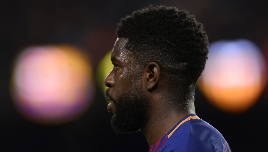 Barcelona's French defender Samuel Umtiti reacts during the Spanish 'Copa del Rey' (King's cup) first leg semi-final football match between FC Barcelona and Valencia CF at the Camp Nou stadium in Barcelona on February 01, 2018. / AFP PHOTO / Josep LAGO        (Photo credit should read JOSEP LAGO/AFP/Getty Images)