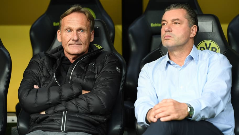 Dortmund's Sport director Michael Zorc (R), CEO Hans-Joachim Watzke are pictured prior to the German Supercup football match final between Borussia Dortmund vs Bayern Munich in Dortmund, western Germany, on August 5, 2017. / AFP PHOTO / PATRIK STOLLARZ / RESTRICTIONS: ACCORDING TO DFB RULES IMAGE SEQUENCES TO SIMULATE VIDEO IS NOT ALLOWED DURING MATCH TIME. MOBILE (MMS) USE IS NOT ALLOWED DURING AND FOR FURTHER TWO HOURS AFTER THE MATCH. == RESTRICTED TO EDITORIAL USE == FOR MORE INFORMATION CONTACT DFB DIRECTLY AT +49 69 67880   /         (Photo credit should read PATRIK STOLLARZ/AFP/Getty Images)