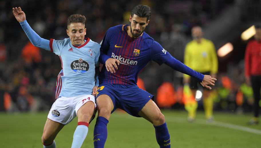Barcelona's Portuguese midfielder Andre Gomes (R)vies with Celta Vigo's Turkish-Danish forward Emre Mor during the Spanish Copa del Rey (King's Cup) round of 16 second leg football match FC Barcelona vs RC Celta de Vigo at the Camp Nou stadium in Barcelona on January 11, 2018. / AFP PHOTO / LLUIS GENE        (Photo credit should read LLUIS GENE/AFP/Getty Images)