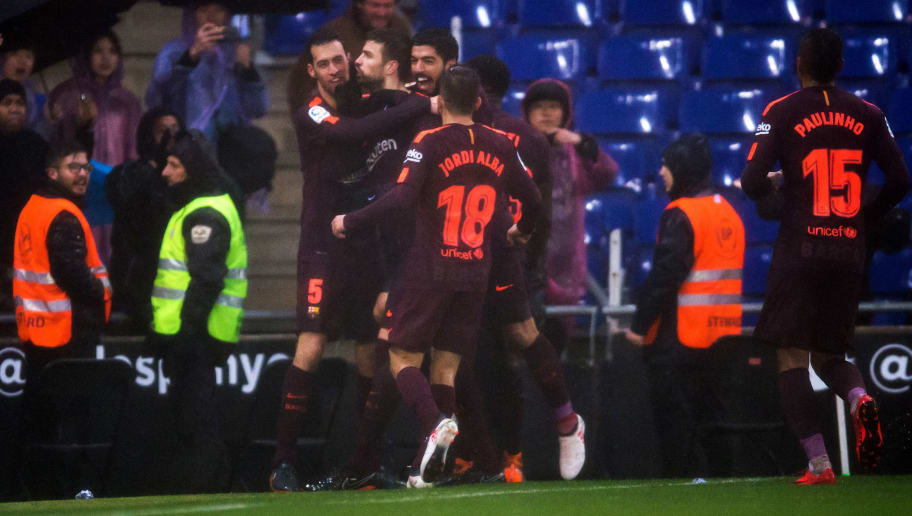 BARCELONA, SPAIN - FEBRUARY 04:  Gerard Pique of FC Barcelona celebrates with teammates after scoring his team's first goal during the La Liga match between Espanyol and Barcelona at RCDE Stadium on February 4, 2018 in Barcelona, Spain.  (Photo by Alex Caparros/Getty Images)