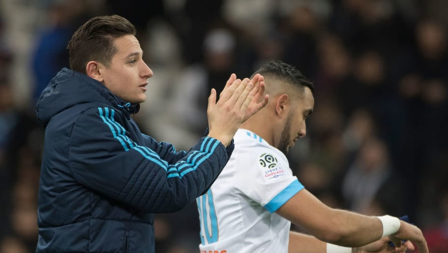 Marseille's French midfielder Florian Thauvin (L) and Marseille's French forward Dimitri Payet react during the French L1 football match Olympique de Marseille versus Metz on February 2, 2018 at the Velodrome stadium in Marseille, southern France.  / AFP PHOTO / BERTRAND LANGLOIS        (Photo credit should read BERTRAND LANGLOIS/AFP/Getty Images)