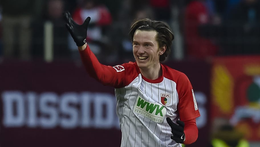 Augsburg's Austrian forward Michael Gregoritsch celebrates his goal during the German first division Bundesliga football match 1 FC Augsburg vs Eintracht Frankfurt in Augsburg, southern Germany, on February 4, 2018. / AFP PHOTO / Guenter SCHIFFMANN / RESTRICTIONS: DURING MATCH TIME: DFL RULES TO LIMIT THE ONLINE USAGE TO 15 PICTURES PER MATCH AND FORBID IMAGE SEQUENCES TO SIMULATE VIDEO. == RESTRICTED TO EDITORIAL USE == FOR FURTHER QUERIES PLEASE CONTACT DFL DIRECTLY AT + 49 69 650050         (Photo credit should read GUENTER SCHIFFMANN/AFP/Getty Images)