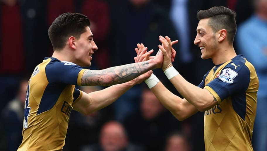 LONDON, UNITED KINGDOM - APRIL 09:  Mesut Ozil (R) of Arsenal celebrates scoring his team's first goal with his team mate Hector Bellerin (L) during the Barclays Premier League match between West Ham United and Arsenal at the Boleyn Ground on April 9, 2016 in London, England.  (Photo by Clive Rose/Getty Images)