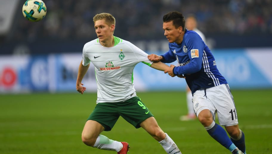 Schalke's Ukrainian midfielder Yevgeny Konoplyanka and Bremen's US forward Aron Johannsson vie for the ball during the German first division Bundesliga football match FC Schalke 04 vs Werder Bremen, in Gelsenkirchen, western Germany, on February 3, 2018. / AFP PHOTO / Patrik STOLLARZ / RESTRICTIONS: DURING MATCH TIME: DFL RULES TO LIMIT THE ONLINE USAGE TO 15 PICTURES PER MATCH AND FORBID IMAGE SEQUENCES TO SIMULATE VIDEO. == RESTRICTED TO EDITORIAL USE == FOR FURTHER QUERIES PLEASE CONTACT DFL DIRECTLY AT + 49 69 650050         (Photo credit should read PATRIK STOLLARZ/AFP/Getty Images)