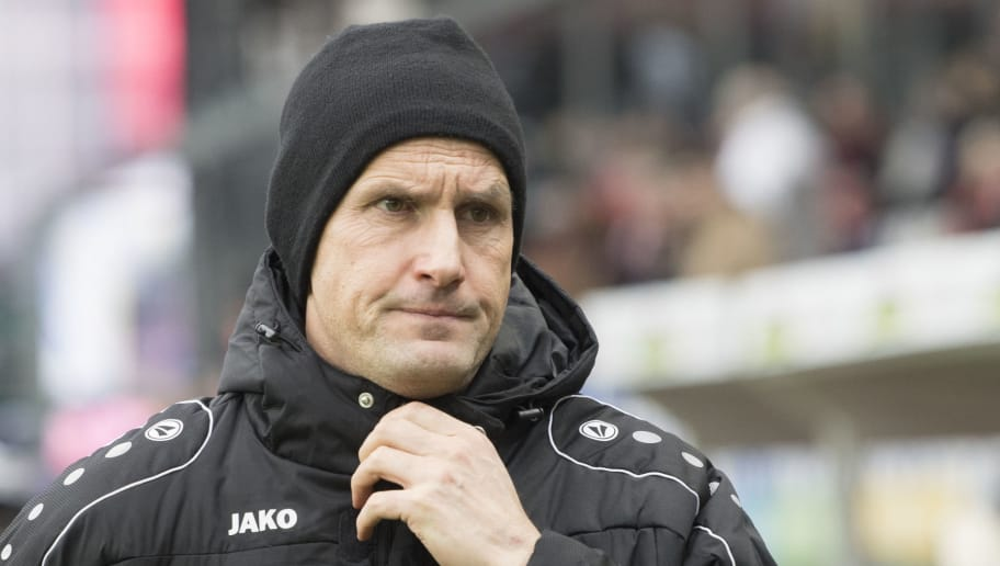 Leverkusen's head coach Heiko Herrlich reacts prior to the German first division Bundesliga football match SC Freiburg versus Bayer Leverkusen on February 3, 2018 in Freiburg. / AFP PHOTO / THOMAS KIENZLE / RESTRICTIONS: DURING MATCH TIME: DFL RULES TO LIMIT THE ONLINE USAGE TO 15 PICTURES PER MATCH AND FORBID IMAGE SEQUENCES TO SIMULATE VIDEO. == RESTRICTED TO EDITORIAL USE == FOR FURTHER QUERIES PLEASE CONTACT DFL DIRECTLY AT + 49 69 650050         (Photo credit should read THOMAS KIENZLE/AFP/Getty Images)