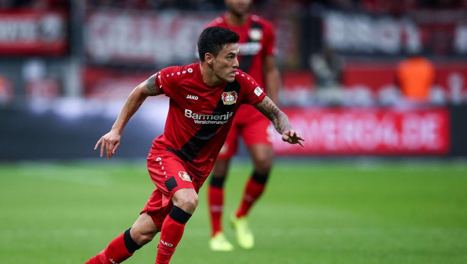 LEVERKUSEN, GERMANY - JANUARY 28: Charles Aranguiz #20 of Bayer Leverkusen controls the ball during the Bundesliga match between Bayer 04 Leverkusen and 1. FSV Mainz 05 at BayArena on January 28, 2018 in Leverkusen, Germany. (Photo by Maja Hitij/Bongarts/Getty Images)