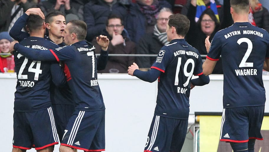 Munich's Bayern Munich's Colombian midfielder James Rodriguez (unseen) is congratulated by teammates after scoring a goal during the German first division Bundesliga football match Mainz 05 versus Bayern Munich on February 3, 2018 in Mainz. / AFP PHOTO / Daniel ROLAND / RESTRICTIONS: DURING MATCH TIME: DFL RULES TO LIMIT THE ONLINE USAGE TO 15 PICTURES PER MATCH AND FORBID IMAGE SEQUENCES TO SIMULATE VIDEO. == RESTRICTED TO EDITORIAL USE == FOR FURTHER QUERIES PLEASE CONTACT DFL DIRECTLY AT + 49 69 650050         (Photo credit should read DANIEL ROLAND/AFP/Getty Images)