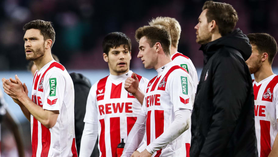 COLOGNE, GERMANY - JANUARY 27: Jonas Hector #14 of 1.FC Koeln (L)  and players react after the Bundesliga match between 1. FC Koeln and FC Augsburg at RheinEnergieStadion on January 27, 2018 in Cologne, Germany. (Photo by Maja Hitij/Bongarts/Getty Images)