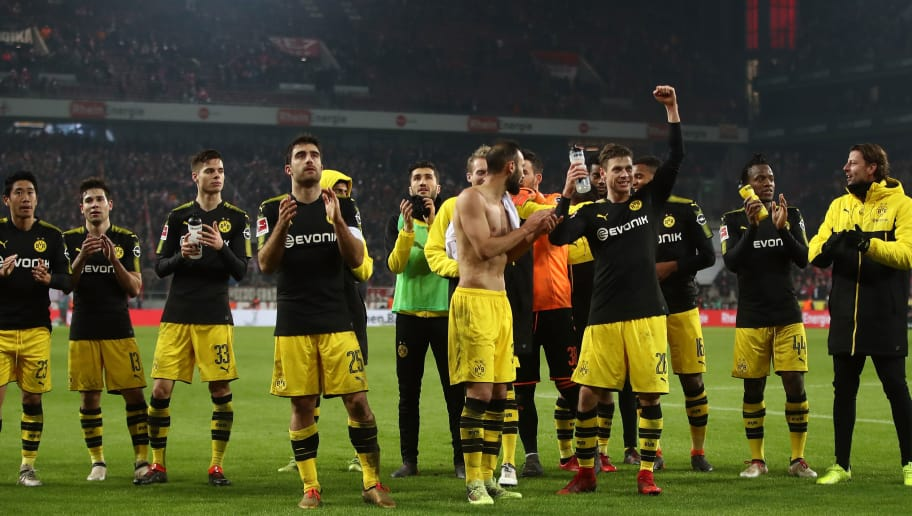 COLOGNE, GERMANY - FEBRUARY 02:  The players of Dortmund celebrate after winning the Bundesliga match between 1. FC Koeln and Borussia Dortmund at RheinEnergieStadion on February 2, 2018 in Cologne, Germany.  (Photo by Alex Grimm/Bongarts/Getty Images)