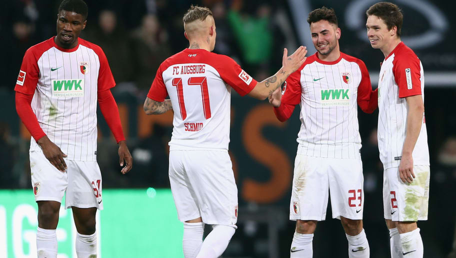 AUGSBURG, GERMANY - FEBRUARY 04: Kevin Danso, Jonathan Schmid, Marco Richter and Raphael Framberger (L-R) of Augsburg celebrate after the Bundesliga match between FC Augsburg and Eintracht Frankfurt at WWK-Arena on February 4, 2018 in Augsburg, Germany.  (Photo by Alex Grimm/Bongarts/Getty Images)