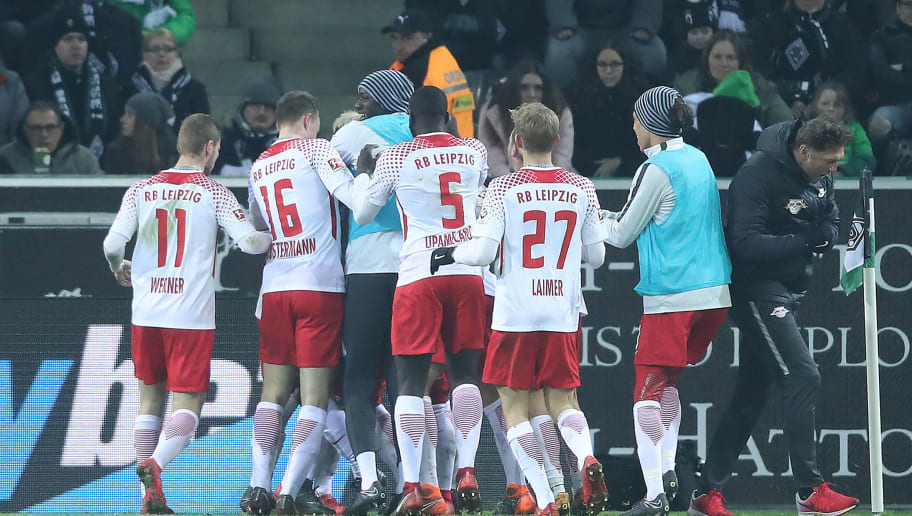 MOENCHENGLADBACH, GERMANY - FEBRUARY 03: Ademola Lookman of Leipzig (covered) celebrates wit his team and coach Ralph Hasenhuettl of Leipzig (r) after he scored a goal to make it 0:1 during the Bundesliga match between Borussia Moenchengladbach and RB Leipzig at Borussia-Park on February 3, 2018 in Moenchengladbach, Germany. (Photo by Christof Koepsel/Bongarts/Getty Images)