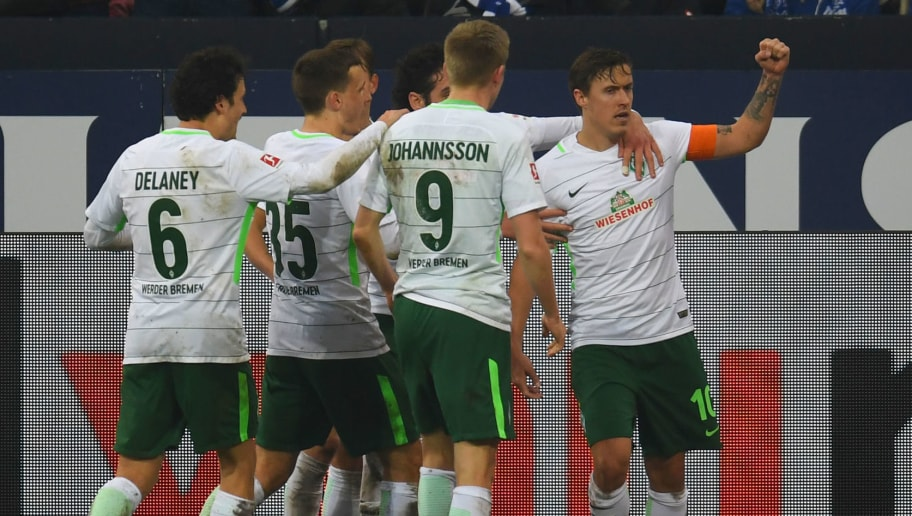 Bremen's players celebrate during the German first division Bundesliga football match FC Schalke 04 vs Werder Bremen, in Gelsenkirchen, western Germany, on February 3, 2018. / AFP PHOTO / Patrik STOLLARZ / RESTRICTIONS: DURING MATCH TIME: DFL RULES TO LIMIT THE ONLINE USAGE TO 15 PICTURES PER MATCH AND FORBID IMAGE SEQUENCES TO SIMULATE VIDEO. == RESTRICTED TO EDITORIAL USE == FOR FURTHER QUERIES PLEASE CONTACT DFL DIRECTLY AT + 49 69 650050         (Photo credit should read PATRIK STOLLARZ/AFP/Getty Images)