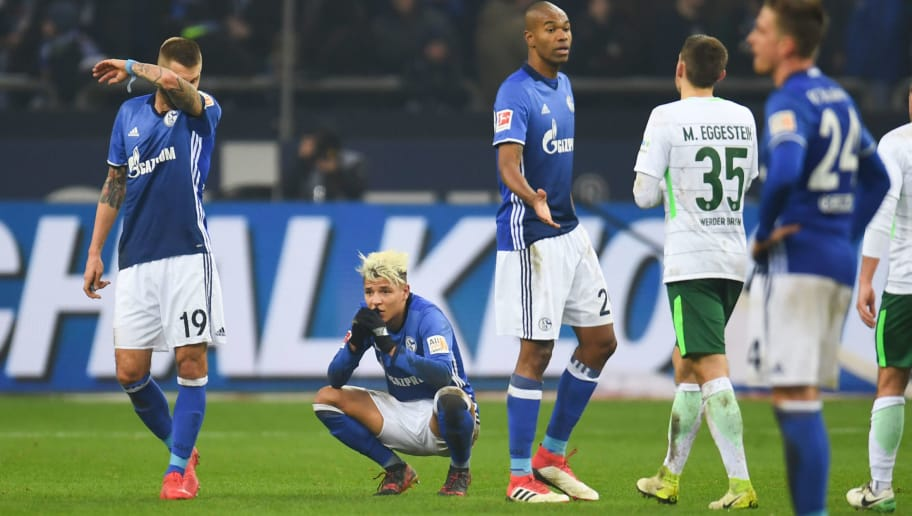 Schalke's players react after the German first division Bundesliga football match Schalke 04 versus Werder Bremen on February 3, 2018 in Gelsenkirchen. / AFP PHOTO / Patrik STOLLARZ / RESTRICTIONS: DURING MATCH TIME: DFL RULES TO LIMIT THE ONLINE USAGE TO 15 PICTURES PER MATCH AND FORBID IMAGE SEQUENCES TO SIMULATE VIDEO. == RESTRICTED TO EDITORIAL USE == FOR FURTHER QUERIES PLEASE CONTACT DFL DIRECTLY AT + 49 69 650050         (Photo credit should read PATRIK STOLLARZ/AFP/Getty Images)