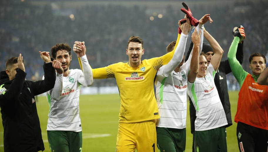 GELSENKIRCHEN, GERMANY - FEBRUARY 03:  Team Bremen with Goalkeeper Jiri Pavlenka of Bremen (M) celebrate the victory 2:1 after the Bundesliga match between FC Schalke 04 and SV Werder Bremen at Veltins-Arena on February 3, 2018 in Gelsenkirchen, Germany. (Photo by Mika Volkmann/Bongarts/Getty Images)