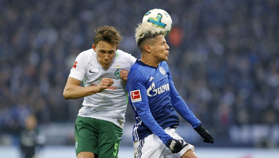 GELSENKIRCHEN, GERMANY - FEBRUARY 03:  Amine Harit of Schalke (R) jumps for a header against Ludwig Augustinsson of Bremen during the Bundesliga match between FC Schalke 04 and SV Werder Bremen at Veltins-Arena on February 3, 2018 in Gelsenkirchen, Germany. (Photo by Mika Volkmann/Bongarts/Getty Images)