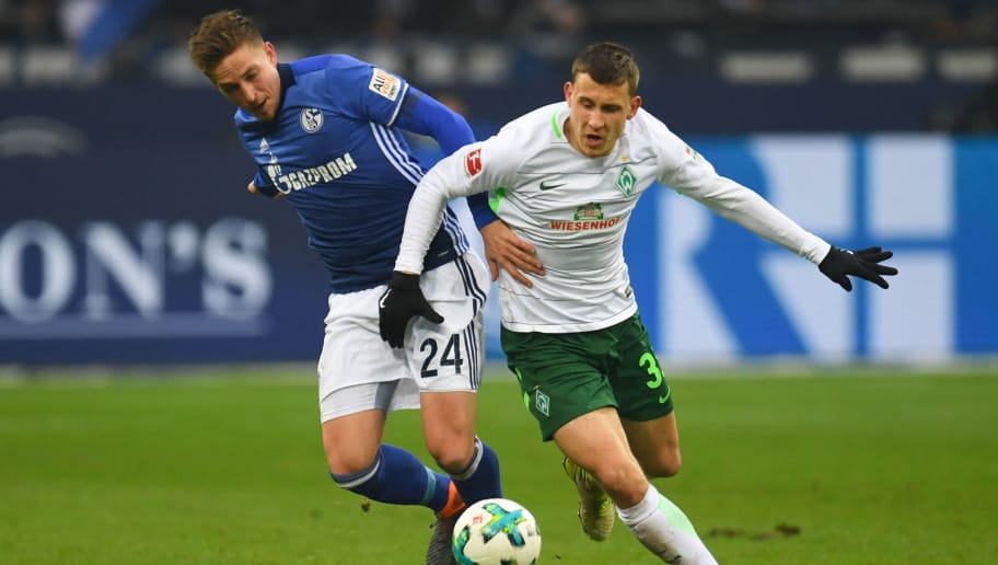 Bremen's German midfielder Maximilian Eggestein and Schalke's German defender Bastian Oczipka vie for the ball during the German first division Bundesliga football match FC Schalke 04 vs Werder Bremen, in Gelsenkirchen, western Germany, on February 3, 2018. / AFP PHOTO / Patrik STOLLARZ / RESTRICTIONS: DURING MATCH TIME: DFL RULES TO LIMIT THE ONLINE USAGE TO 15 PICTURES PER MATCH AND FORBID IMAGE SEQUENCES TO SIMULATE VIDEO. == RESTRICTED TO EDITORIAL USE == FOR FURTHER QUERIES PLEASE CONTACT DFL DIRECTLY AT + 49 69 650050         (Photo credit should read PATRIK STOLLARZ/AFP/Getty Images)