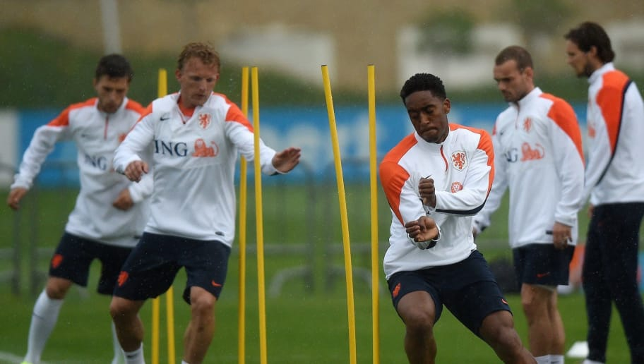 Netherlands' defender Terence Kongolo (C) and his teammates take part in a training session of the Dutch national football team in Lagos, southern Portugal, on May 20, 2014, as part of the team's preparation for the upcoming FIFA 2014 World Cup in Brazil.  AFP PHOTO / FRANCISCO LEONG        (Photo credit should read FRANCISCO LEONG/AFP/Getty Images)