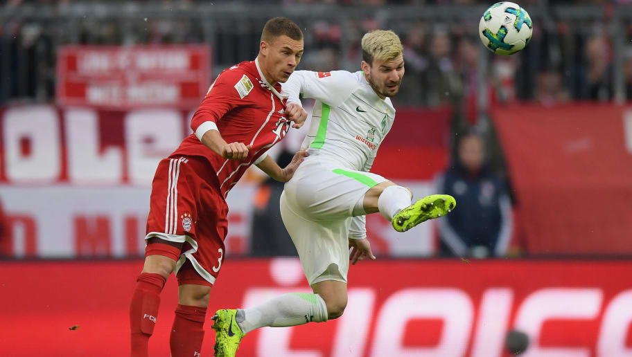 MUNICH, GERMANY - JANUARY 21: Joshua Kimmich of FC Bayern Muenchen  jumps for a header with Jerome Gondorf of Bremen during the Bundesliga match between FC Bayern Muenchen and SV Werder Bremen at Allianz Arena on January 21, 2018 in Munich, Germany. (Photo by Matthias Hangst/Bongarts/Getty Images)