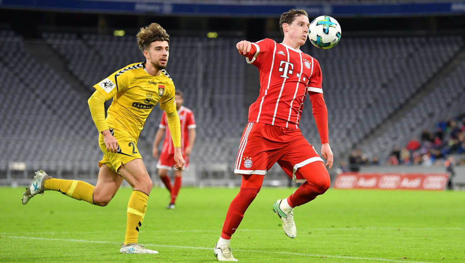 MUNICH, GERMANY - JANUARY 09: Sebastian Rudy of Bayern Muenchen plays the ball in front of Dominik Pelivan of Sonnenhof Grossaspach during the friendly match between Bayern Muenchen and SG Sonnenhof Grossaspach at Allianz Arena on January 9, 2018 in Munich, Germany. (Photo by Sebastian Widmann/Bongarts/Getty Images)