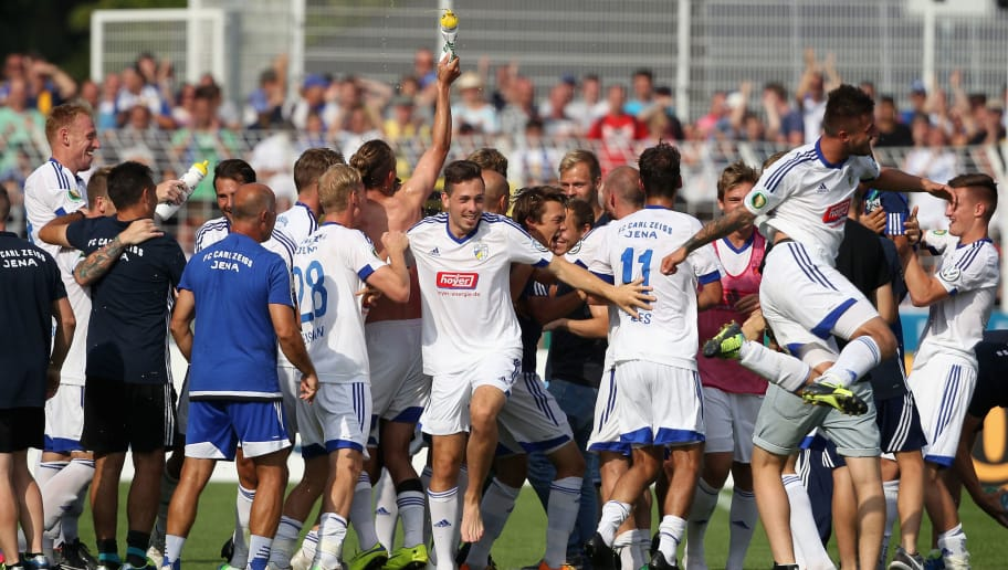JENA, GERMANY - AUGUST 09:  Team of Jena celebrates the victory after the First Round of DFB-Cup between FC Carl Zeiss Jena and Hamburger SV at Ernst-Abbe-Sportfeld on August 09, 2015 in Jena, Germany.  (Photo by Karina Hessland/Bongarts/Getty Images)