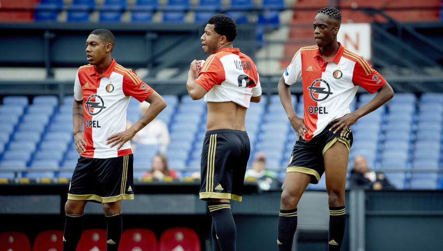 Feyenoord Rotterdam's (L-R) Dutch midfielder Jean-Paul Boetius, Dutch midfielder Tonny Vilhena and Dutch defender Terence Kongolo attend the football club's first training session of the 2015-2016 season in Rotterdam on June 28, 2015. AFP PHOTO / ANP / MARTIJN BEEKMAN  == NETHERLANDS OUT ==        (Photo credit should read Martijn Beekman/AFP/Getty Images)