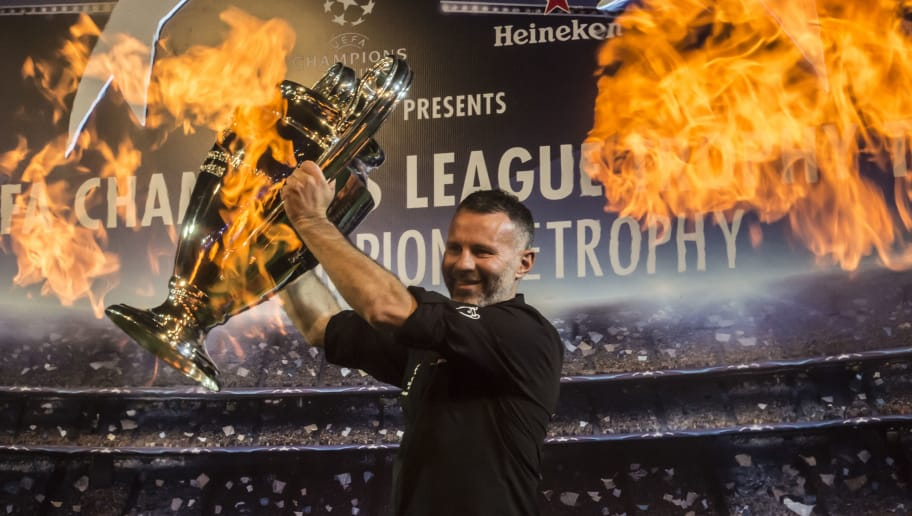CAIRO, EGYPT - APRIL 05: Former footballer Ryan Giggs holds the UEFA champions league trophy during a tour on April 5, 2017 in Cairo, Egypt. (Photo by Getty Images/Getty Images)