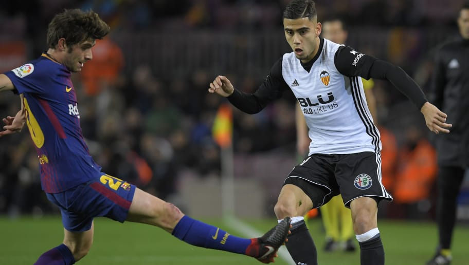 Barcelona's Spanish midfielder Sergi Roberto (L) vies with Valencia's Brazilian forward Andreas Pereira during the Spanish 'Copa del Rey' (King's cup) first leg semi-final football match between FC Barcelona and Valencia CF at the Camp Nou stadium in Barcelona on February 01, 2018. / AFP PHOTO / LLUIS GENE        (Photo credit should read LLUIS GENE/AFP/Getty Images)