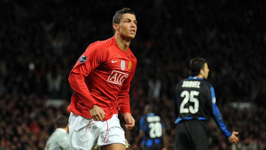 Manchester United's Portugese midfielder Cristiano Ronaldo celebrates scoring against Inter Milan during their UEFA Champions League second round second leg football match at Old Trafford in Manchester, north west England on March 11, 2009. AFP PHOTO/ANDREW YATES (Photo credit should read ANDREW YATES/AFP/Getty Images)