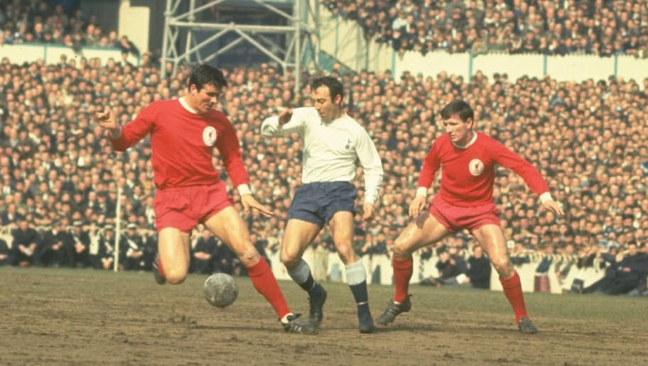 1965:  Jimmy Greaves (centre) of Tottenham Hotspur sneaks in between Ron Yeats (left) and Tommy Smith (right) of Liverpool during the match between Spurs and Liverpool at White Hart Lane, London.   \ Mandatory Credit: Allsport UK /Allsport