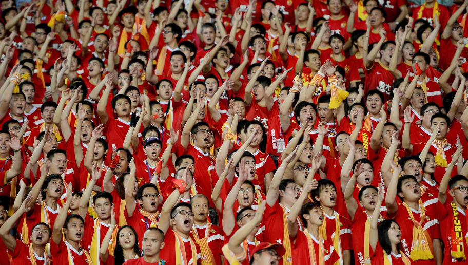 GUANGZHOU, CHINA - NOVEMBER 09:  Supporters for Guangzhou Evergrande cheer during the AFC Champions League Final 2nd leg match between Guangzhou Evergrande and FC Seoul at Guangzhou Tianhe Sport Center Stadium on November 9, 2013 in Guangzhou, China.  (Photo by Thananuwat Srirasant/Getty Images)