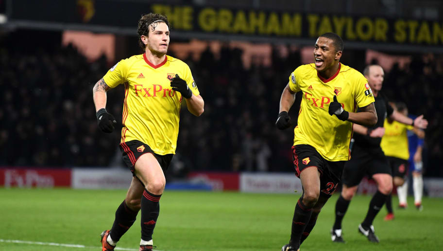 WATFORD, ENGLAND - FEBRUARY 05:  Daryl Janmaat of Watford celebrates scoring the 2nd Watford goal with Marvin Zeegelaar of Watford during the Premier League match between Watford and Chelsea at Vicarage Road on February 5, 2018 in Watford, England.  (Photo by Michael Regan/Getty Images)