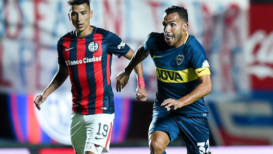 BUENOS AIRES, ARGENTINA - FEBRUARY 04: Carlos Tevez of Boca Juniors fights for ball with Ruben Botta of San Lorenzo during a match between San Lorenzo and Boca Juniors as part of the Superliga  at Pedro Bidegain Stadium on February 4, 2018 in Buenos Aires, Argentina.  (Photo by Marcelo Endelli/Getty Images)