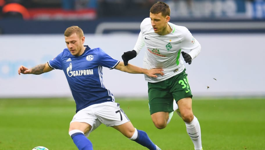 Bremen's German midfielder Maximilian Eggestein and Schalke's German midfielder Max Meyer vie for the ball during the German first division Bundesliga football match FC Schalke 04 vs Werder Bremen, in Gelsenkirchen, western Germany, on February 3, 2018. / AFP PHOTO / Patrik STOLLARZ / RESTRICTIONS: DURING MATCH TIME: DFL RULES TO LIMIT THE ONLINE USAGE TO 15 PICTURES PER MATCH AND FORBID IMAGE SEQUENCES TO SIMULATE VIDEO. == RESTRICTED TO EDITORIAL USE == FOR FURTHER QUERIES PLEASE CONTACT DFL DIRECTLY AT + 49 69 650050         (Photo credit should read PATRIK STOLLARZ/AFP/Getty Images)