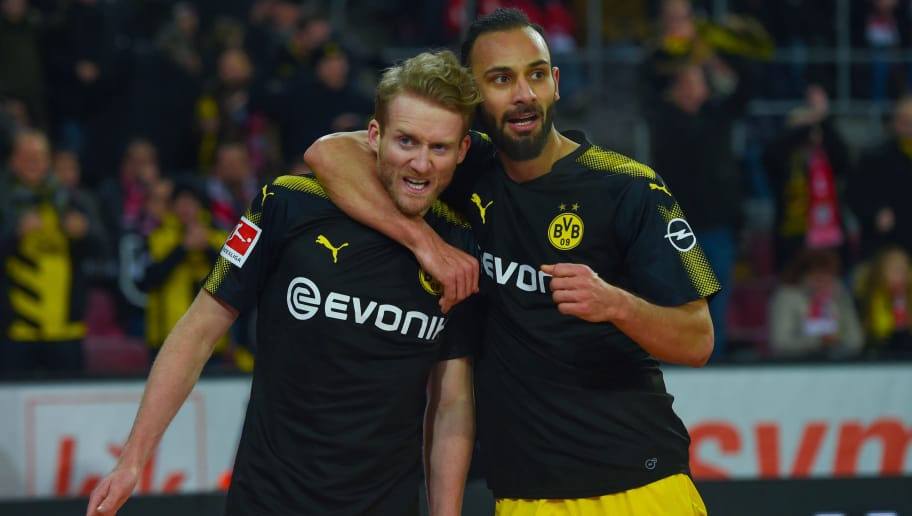 Dortmund's German midfielder Andre Schuerrle (L) celebrates with Dortmund's Turkish defender Omer Toprak after scoring a goal during the German first division Bundesliga football match FC Cologne versus Borussia Dortmund in Cologne, western Germany, on February 2, 2018. / AFP PHOTO / Patrik STOLLARZ / RESTRICTIONS: DURING MATCH TIME: DFL RULES TO LIMIT THE ONLINE USAGE TO 15 PICTURES PER MATCH AND FORBID IMAGE SEQUENCES TO SIMULATE VIDEO. == RESTRICTED TO EDITORIAL USE == FOR FURTHER QUERIES PLEASE CONTACT DFL DIRECTLY AT + 49 69 650050         (Photo credit should read PATRIK STOLLARZ/AFP/Getty Images)