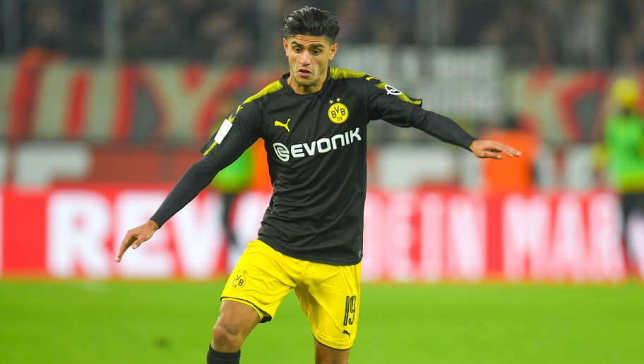 Dortmund's German midfielder Mahmoud Dahoud controls the ball during the German first division Bundesliga football match FC Cologne versus Borussia Dortmund in Cologne, western Germany, on February 2, 2018. / AFP PHOTO / Patrik STOLLARZ / RESTRICTIONS: DURING MATCH TIME: DFL RULES TO LIMIT THE ONLINE USAGE TO 15 PICTURES PER MATCH AND FORBID IMAGE SEQUENCES TO SIMULATE VIDEO. == RESTRICTED TO EDITORIAL USE == FOR FURTHER QUERIES PLEASE CONTACT DFL DIRECTLY AT + 49 69 650050         (Photo credit should read PATRIK STOLLARZ/AFP/Getty Images)