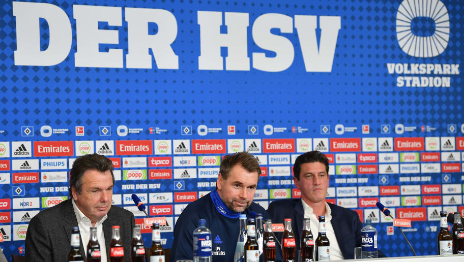 HAMBURG, GERMANY - JANUARY 22:  Heribert Bruchhagen, manager of Hamburg, Bernd Hollerbach, new head coach of Hamburger SV and Jens Todt, sports director of Hamburg talk to the media during a press conference of Hamburger SV at Volksparkstadion on January 22, 2018 in Hamburg, Germany.  (Photo by Stuart Franklin/Bongarts/Getty Images)