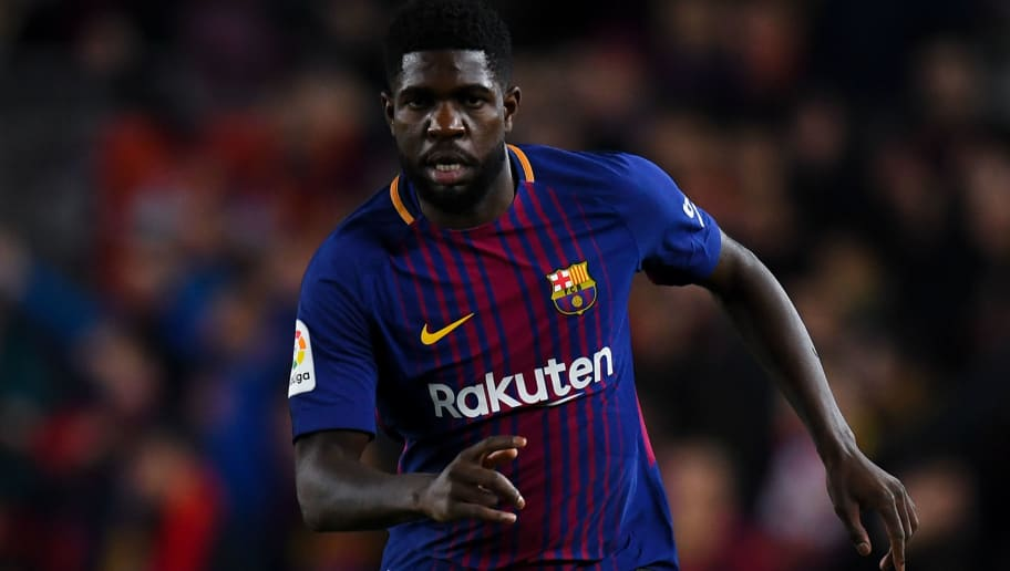 BARCELONA, SPAIN - JANUARY 28:  Samuel Umtiti of FC Barcelona runs with the ball during the La Liga match between Barcelona and Deportivo Alaves at Camp Nou on January 28, 2018 in Barcelona, Spain.  (Photo by David Ramos/Getty Images)
