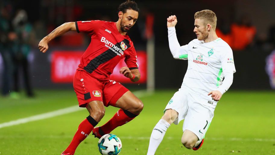 LEVERKUSEN, GERMANY - DECEMBER 13:  Karim Bellarabi (L) of Bayer 04 Leverkusen battles for the ball with Florian Kainz of Werder Bremen during the Bundesliga match between Bayer 04 Leverkusen and SV Werder Bremen at BayArena on December 13, 2017 in Leverkusen, Germany.  (Photo by Dean Mouhtaropoulos/Bongarts/Getty Images)