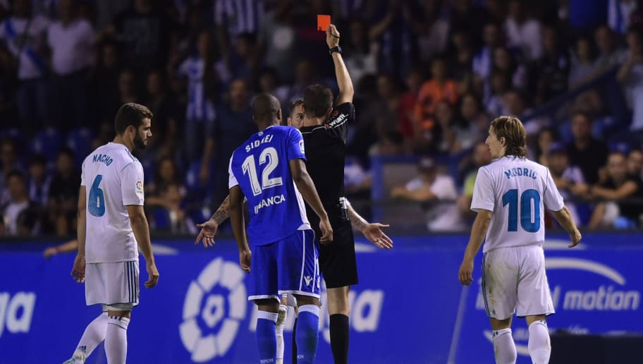 TOPSHOT - Real Madrid's defender Sergio Ramos is shown a red card by the referee during the Spanish league footbal match RC Deportivo de la Coruna vs Real Madrid CF at the Municipal de Riazor stadium in La Coruna on August 20, 2017. Real Madrid won 3-0. / AFP PHOTO / MIGUEL RIOPA        (Photo credit should read MIGUEL RIOPA/AFP/Getty Images)
