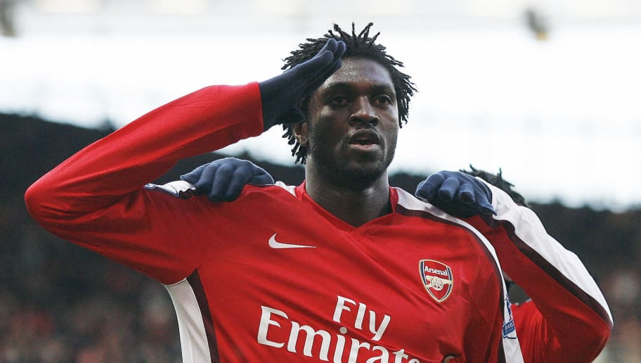 Arsenal's Togolese Striker Emmanuel Adebayor celebrates scoring against Wigan during their Premier League match at the Emirates Stadium, London, on December 6, 2008. AFP PHOTO / Glyn Kirk  FOR EDITORIAL USE ONLY Additional licence required for any commercial/promotional use or use on TV or internet (except identical online version of newspaper) of Premier League/Football League photos. Tel DataCo +44 207 2981656. Do not alter/modify photo (Photo credit should read GLYN KIRK/AFP/Getty Images)