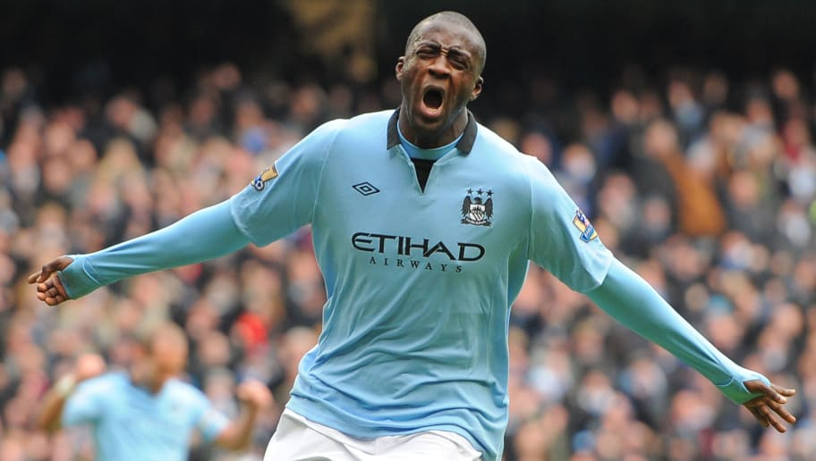 """Manchester City's Ivorian midfielder Yaya Toure celebrates scoring the opening goal of the English Premier League football match between Manchester City and Chelsea at the Etihad Stadium in Manchester, northwest England, on February 24, 2013.  AFP PHOTO/ANDREW YATES  RESTRICTED TO EDITORIAL USE. No use with unauthorized audio, video, data, fixture lists, club/league logos or """"live"""" services. Online in-match use limited to 45 images, no video emulation. No use in betting, games or single club/league/player publications.        (Photo credit should read ANDREW YATES/AFP/Getty Images)"""