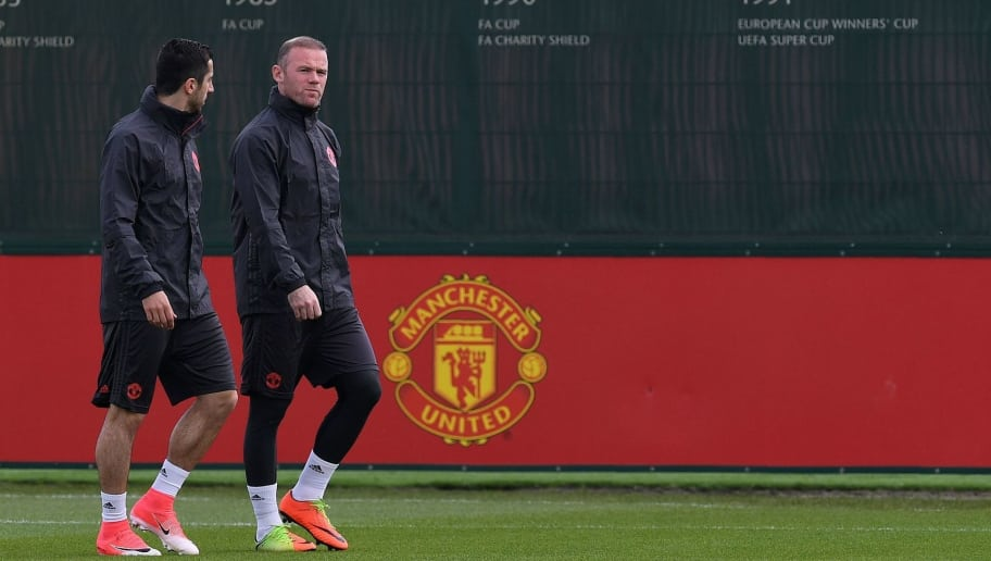 Manchester United's English striker Wayne Rooney (R) and Manchester United's Armenian midfielder Henrikh Mkhitaryan attend a team training session at the club's training complex near Carrington, west of Manchester in north west England on May 23, 2017, on the eve of their UEFA Europa League final football match against Ajax. / AFP PHOTO / Paul ELLIS        (Photo credit should read PAUL ELLIS/AFP/Getty Images)